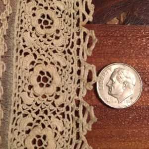 Closeup of Irish crochet cuff trim, which is expletive tiny